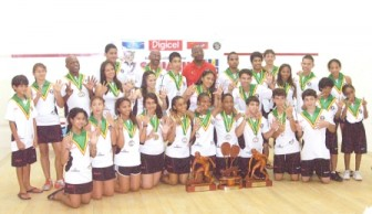 The overall champions, Guyana pose with their trophies and medals at the closing ceremony yesterday at the Georgetown Club Courts.
