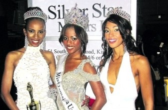 Newly-crowned Miss Jamaica Universe 2011, Shakira Martin, is flanked by her runners-up Kadyan Salmon (left) and Chantal Zacky, at the National Indoor Sports Centre in Kingston early Sunday morning. (Jamaica Observer photo)