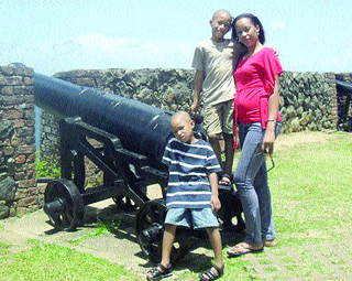 Vonetta Haynes-Reyes, 31, and her sons, Malik, eight, and Makasi, four, at a fort in a photo from the family album. (Trinidad Express photo)