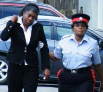 Attorney Vonda Pile (left) on the way to court yesterday. (Barbados Nation photo)
