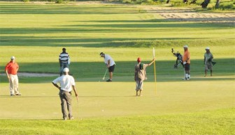 Some of the action during yesterday's farewell golf tournament for Canadian High Commissioner, Francois Montour.