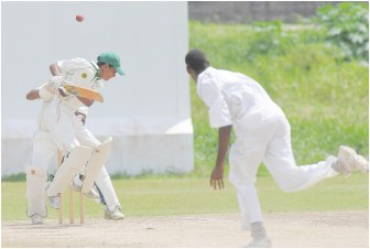 Guyana's number 11 Lloydel Lewis evades a bouncer from Justin Greaves yesterday morning.