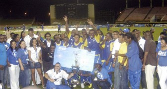 The jubilant Pele FC celebrates with winning cheque and trophy at the presentation ceremony. (Orlando Charles photo)