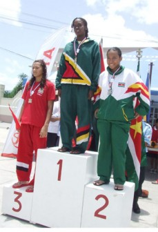 Guyana's Noelle Smith on the podium after her gold medal wins.