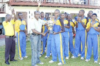 Rawle Lewis presents the 2011 West Indies Cricket Board under-19 limited overs trophy to Barbados skipper Kraigg  Brathwaite . (Orlando Charles photo)