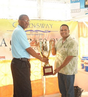 GCA President Roger Harper receives the tournament winner's trophy from Queensway Managing Director Mohamed Qualander.