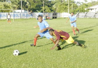 Action in the match between the Guyana Police Force and Charlestown United Sunday night at the Tucville Playfield. (Orlando Charles photo)
