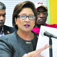 Kamla Persad-Bissessar announcing the emergency yesterday