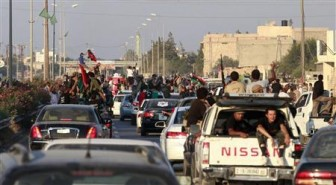 Libyan rebel fighters and civilians ride through the town of Maia celebrating after rebels pushed to within 25 kms (15 miles) of Tripoli, August 21, 2011. REUTERS/Bob Strong