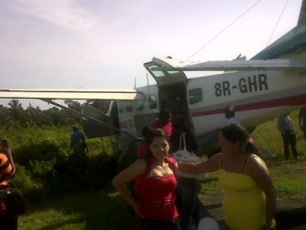 The plane just after it had run off of the airstrip. Passengers can be seen just having disembarked.