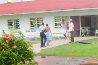 The tortured boy (second from left) as he was taken to the hospital in 2009 (Stabroek News file photo)