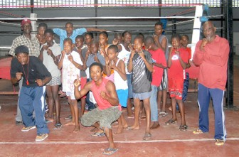 FIGHTING HUNGER! The boxers from Berbice who were abandoned for several hours yesterday by the Guyana Amateur Boxing Association (GABA) put up a brave face for Stabroek News's photographer Orlando Charles.