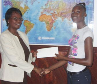 In  picture from left, June Ann Hyles, Human Resources Assistant, presents the cheque to Hazina Barrett.
