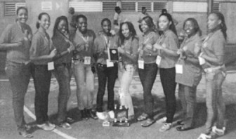 The Guyana Netball Team display their medals