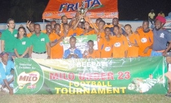 They came, saw and conquered! The victorious Under-23 Fruta Conquerors players pose with their winning cheque on Sunday at the Tucville Playfield. (Orlando Charles photo)