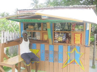 Gairy Croal in front of his shop