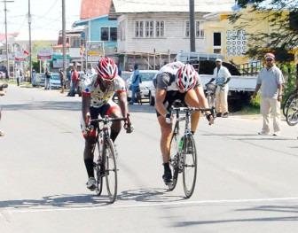 Godfrey Pollydore (left) and Jonathan Teeter at the end of stage one in a dead heat finish yesterday. (Photo by Orlando Charles)
