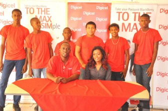 The six young Guyanese footballers with Digicel's Gavin Hope and Shonette Moore.