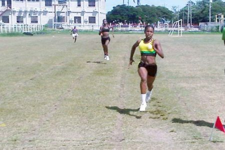 Shaquan Daniels runs away in the female under-16 400 metres yesterday at the North Zone Inter- Schools Championships. (Orlando Charles photo)