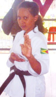 Caribbean Karate Championships gold medallist Leah Shariff strikes a pose during her demonstration on Sunday at a grading exam.