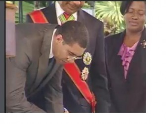 Andrew Holness being sworn in this afternoon (Jamaica Information Service photo)