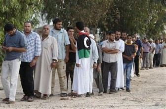 People stand in line to see the body of former Libyan leader Muammar Gaddafi in Misrata today. REUTERS/Saad Shalash