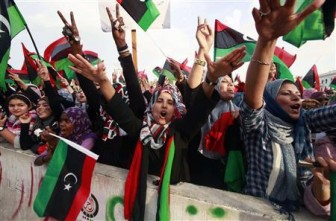 "Women celebrate the liberation of Libya at Martyrs' Square in Tripoli October 23, 2011. Libya's new rulers declared the country freed from Muammar Gaddafi's 42 years of one-man rule on Sunday, saying the ""Pharaoh of the times"" was now in history's garbage bin and a democratic future beckoned. REUTERS/Suhaib Salem"