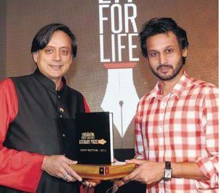 "'A WICKET MAIDEN': Shashi Tharoor, MP, presenting The Hindu Literary Prize for Best Fiction 2011 to debutant novelist Rahul Bhattacharya for his ""The Sly Company of People Who Care"" in Chennai (Hindu Times photo)"