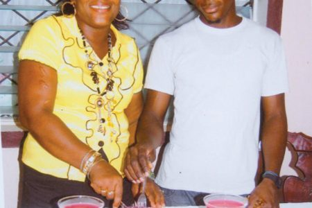 Winifred Watson and her 19-year-old son Stephen sticking a cake to celebrate her 50th birthday.