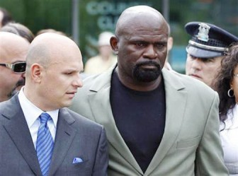 Former NFL football player Lawrence Taylor (R) leaves Rockland County Court with his attorney Arthur Aidala after pleading not guilty to third-degree rape charges after his arraignment in New City, New York, July 13, 2010.