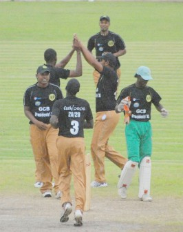 The GCB President's XI celebrates the fall of another wicket. (Orlando Charles Photo)