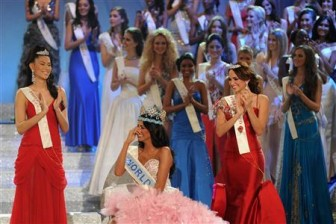 Miss Venezuela, Ivian Sarcos, reacts after being crowned Miss World 2011 in Earls Court in west London today. Reuters/Paul Hackett