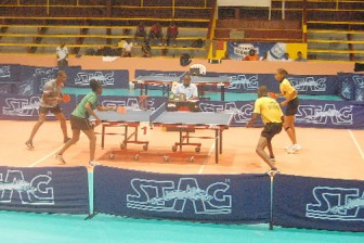 Some of the action during the finals in the mixed doubles competition yesterday at the National Gymnasium.