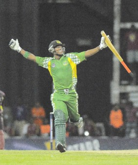 Leon Johnson celebrates after hitting  a six to give Guyana a five wicket win over the Leeward Islands in the second match of the Caribbean T20 tournament last night at the Sir Vivian Richards Stadium in Antigua. (Photo courtesy WindiesCricket.com)