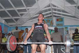 MIGHTY MC DONALD! GMR&SC's Jamie McDonald deadlifting 190kgs at the GAPF Junior/Novices Powerlifting Championships last Sunday at Blairmont Primary School. (Orlando Charles photo)