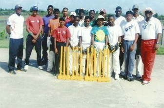 The wicket keepers pose with the coaches after the clinic