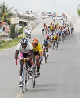 The peloton  descend  the Canje Bridge on its  way to No 55 Village, Corentyne, aBerbice. (Orlando Charles photo)