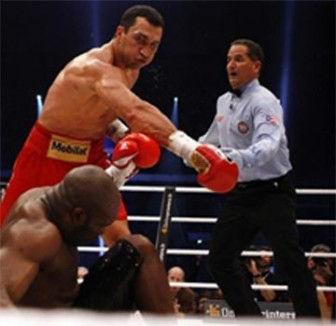 Heavyweight boxing title holder Vladimir Klitschko of Ukraine lands the knockout punch on Jean-Marc Mormeck of France during their IBF/WBO, WBA and IBO world heavyweight championship title fight in Duesseldorf Saturday. Klitschko won the fight with a K.O. in the fourth round. REUTERS/Kai Pfaffenbach. (Reuters photo)