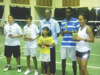 Winners of the recent Mashramani Badminton tournament along with Director of Sport Neil Kumar