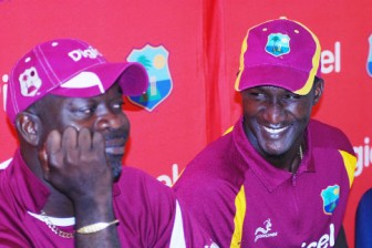 HAPPY TIMES: West Indies captain Darren Sammy (right) shares a laugh with coach Ottis Gibson at yesterday's media conference. (Photo by Windiescricket.com)