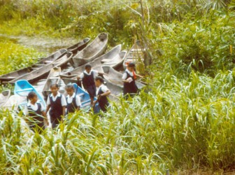 After parking their canoes, the children of Wallaba Primary head to school.