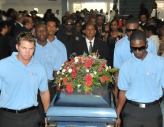Members of the Queen's Park Cricket Club carrying the casket into the church. (Trinidad Express)