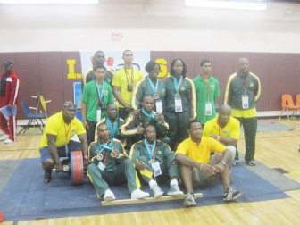The victorious Guyana men's team posing with their medals.