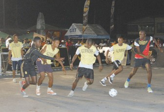 Action during the opening night of the tournament at Wisroc Amelia's Ward Bus Park. (Orlando Charles Photo)