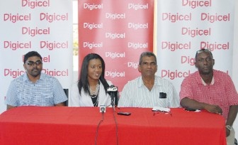 PRO of Digicel Shonnet Moore makes a point at the presentation while from left CEO of AJ Promotions Bhudesh Chatterpaul, Secretary of the Port Mourant Turf Club Chattergoon Ramnauth and Sponsorship and Events Manager of Digicel Gavin Hope look on. (Orlando Charles photo)