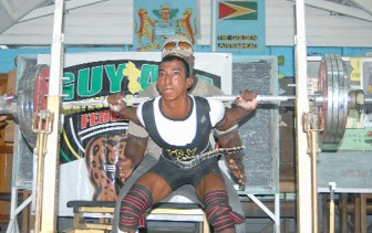RECORD BREAKER! Vijai Rahim during his record breaking squat at the 2012 Novices and Intermediate Powerlifting competition in February. (Orlando Charles photo)
