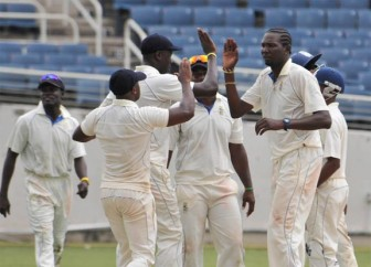 Left-arm spinner Sulieman Benn, right celebrates the fall of another Jamaican batsman's wicket. Benn picked up 5-90. (Westindiescricket.com)