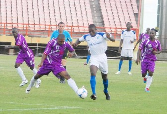 A Milerock player, right and a Hubentut Fortuna's player fighting for possession during the Caribbean Football Union (CFU) Club Championship game which was played yesterday at the Providence National Stadium. (Orlando Charles photo)