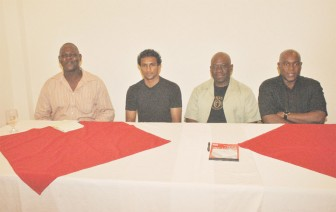 From left, GABA's Technical Director Terrence Poole, CABOFE bantamweight champion Elton Dharry, Briso Promotions CEO Seon Bristol and GABA's President Steve Ninvalle pose for a photo opportunity yesterday in the boardroom of the Princess Hotel. (Aubrey Crawford photo)
