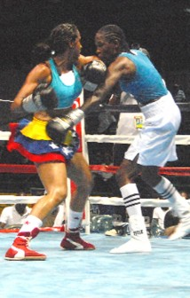 Ana Lozano left and Mandessa Moses going at it in their six-round super featherweight fight Friday night at the Cliff Anderson Sports Hall. (Orlando Charles photo)